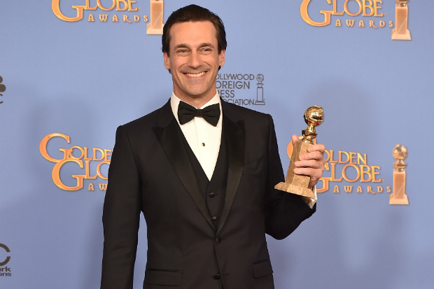 Jon Hamm all smiles after winning his second Globe for Best Actor in a Drama Series.